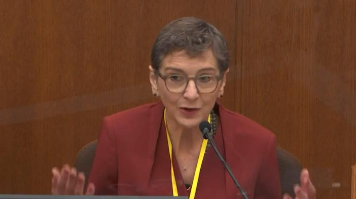 In this image from video, Dr. Lindsey Thomas, a forensic pathologist, now retired, testifies as Hennepin County Judge Peter Cahill presides, Friday, April 9, 2021.